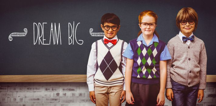 The word dream big and cute pupils against teal, blue