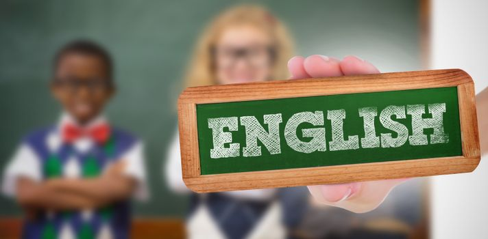 The word english and hand showing chalkboard against pupils smiling at camera with arms crossed