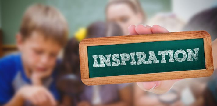 Inspiration against cute pupils looking through magnifying glass