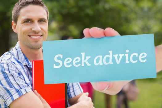 Seek advice against happy student smiling at camera outside on campus