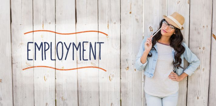 Employment against pretty brunette thinking and smiling