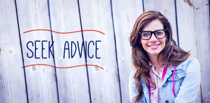 Seek advice against pretty woman smiling at camera