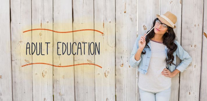 The word adult education against pretty brunette thinking and smiling