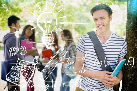 Education doodles against handsome student smiling at camera outside