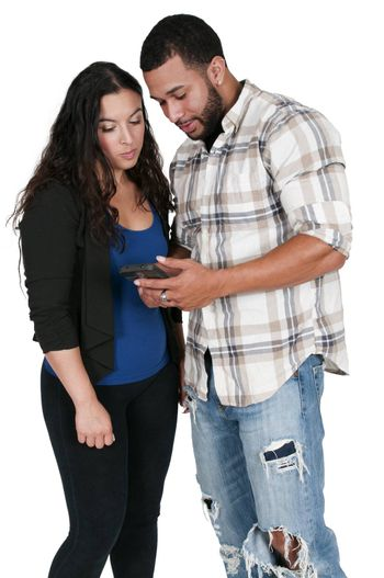 Woman and man texting or accessing the Internet with a cell phone