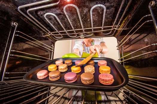 Baking macarons in the oven.