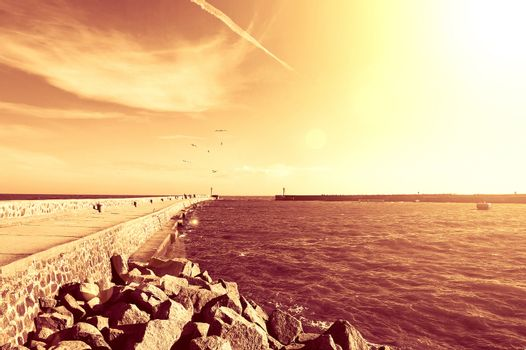 Summer. Warm red summer over sea with jetty.