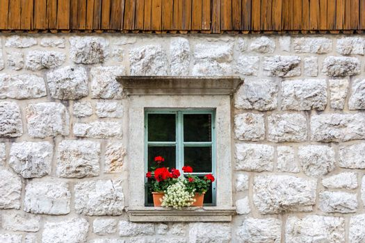 Traditional alpine stone window.
