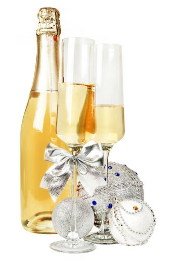 Champagne sparkling wine and new year silver glitter balls composition