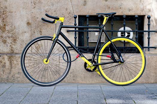 Cool black and yellow bike locked
