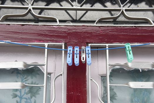 closed up the coat hanger behind window in local house, Nepal