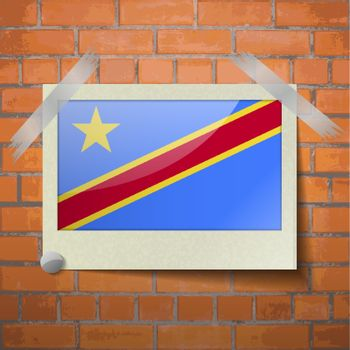Flags Congo Democratic Republic scotch taped to a red brick wall