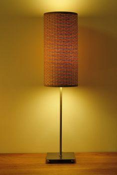 single cream lampshade on wood table