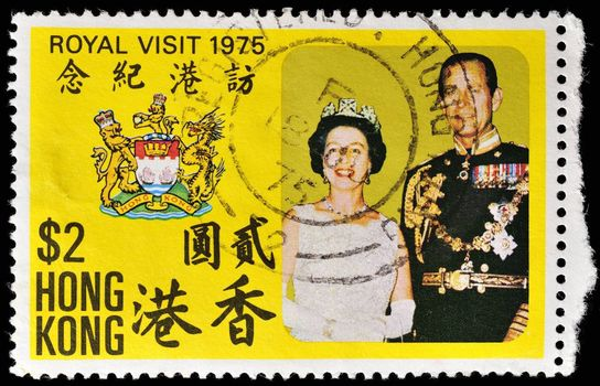 HONG KONG - CIRCA 1975: A stamp printed in the Hong Kong dedicated to the visit of Queen Elizabeth II and Prince Philip, shows a portrait of the, coat of arms of Hong Kong, circa 1975