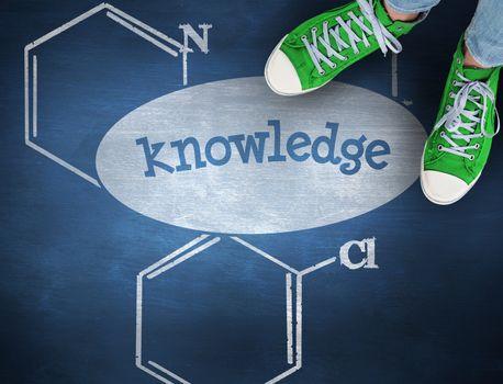 Knowledge against blue chalkboard