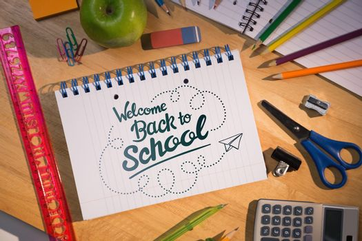 back to school against students table with school supplies