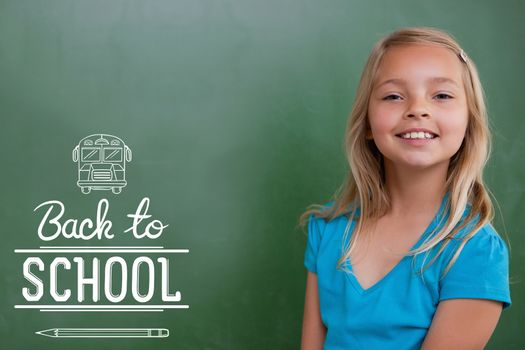 back to school against cute pupil smiling