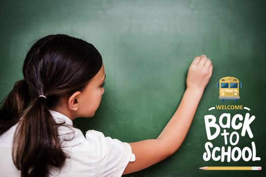 back to school against cute pupil writing on chalkboard