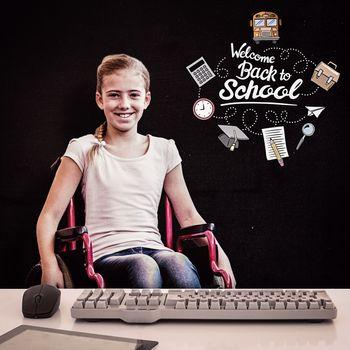 Girl sitting in wheelchair in school corridor against black