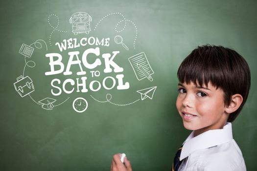 back to school against cute pupil holding chalk
