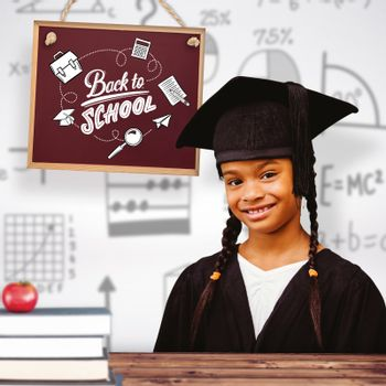 Cute pupil graduating against wooden planks background