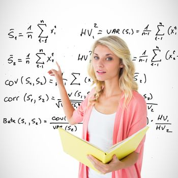 Young pretty student pointing and reading against maths equations