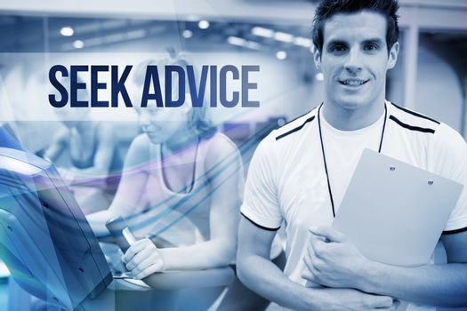Seek advice against spinning class instructor holding clipboard