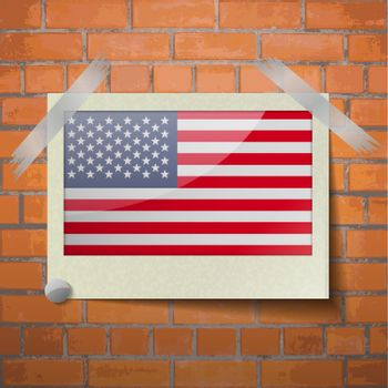 Flags USA scotch taped to a red brick wall