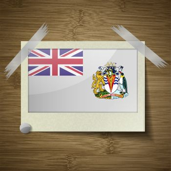 Flags British Antarctic Territory at frame on wooden texture. Vector