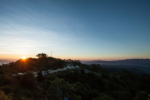 Sunrise over the mountains with the mist of the Huay Nam Dang Na