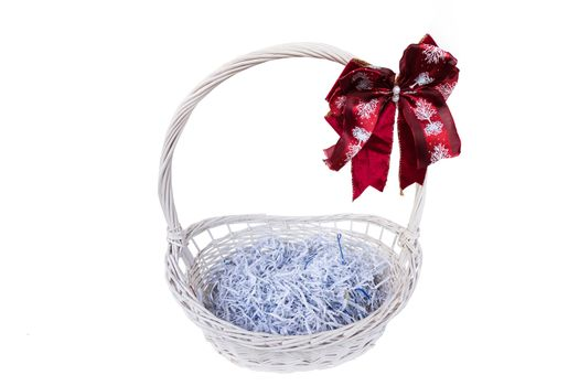 basket with a red bow isolated on white