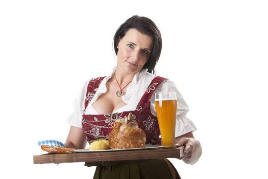 bavarian woman in a dirndl with pork