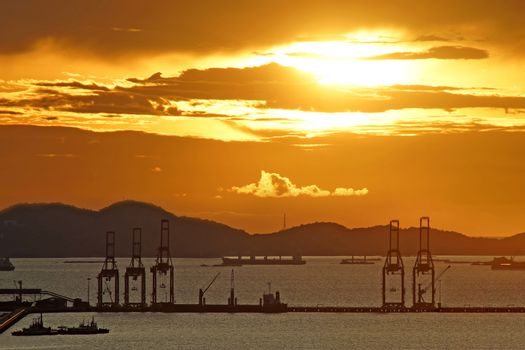 silhouette of port warehouse and crane bridge