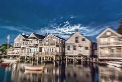 Blurred night view of wooden homes over water, Nantucket