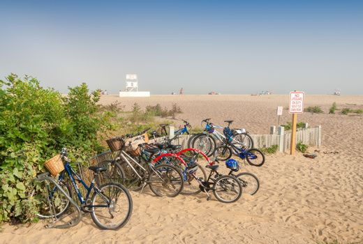 NANTUCKET, MA - JULY 13, 2008: Parked bicycles on the beach in s