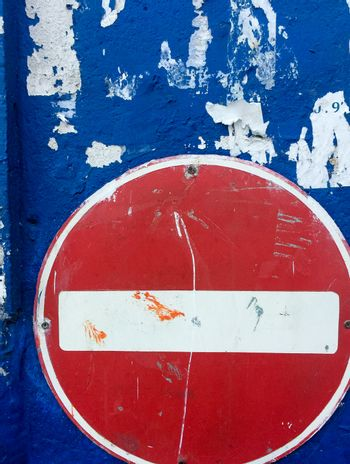 No entry sign on blue background wall