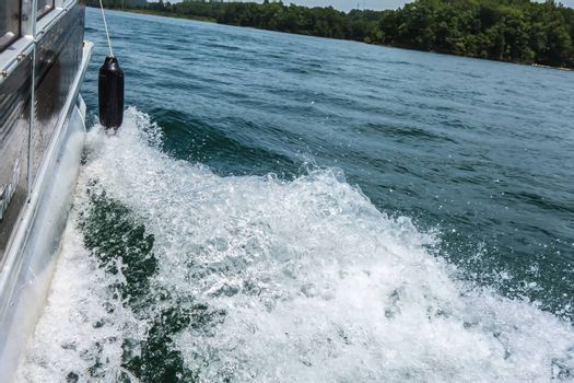Waves on lake behind the speed boat