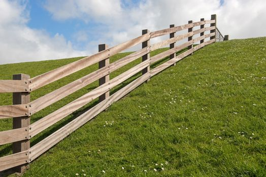 Wooden fence on a dyke