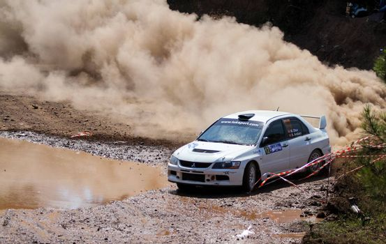 ISTANBUL, TURKEY - JULY 26, 2015: Menderes Okur drives Mitsubishi Lancer Evo IX of Tok Sport WRT Team in Bosphorus Rally 2015, Gocbeyli stage