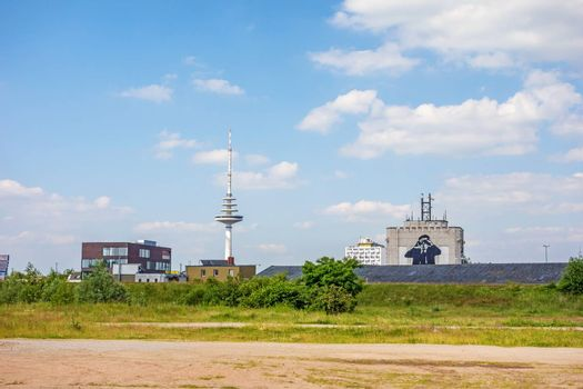 Bremen, Germany - June 6, 2014: Communication / television tower Waller-Spargel with noticeable building (man with binoculars) in district Walle