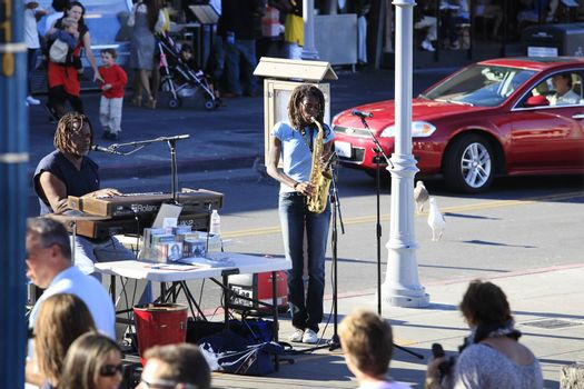San Francisco, USA - October, 19 2012: A street musician plays the saxophone in San Francisco, California.