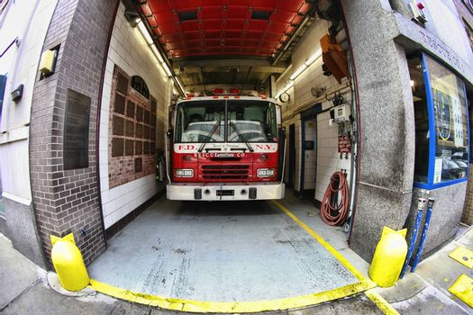 New York, USA - October 10, 2012: Fire engine vehicles parked at a fire station in New York