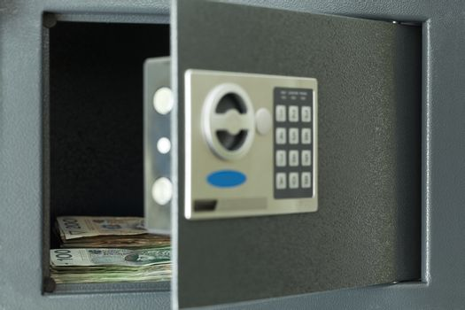open safe full with notes (hundred and two zloty)