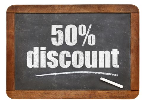 fifty percent discount sign - white chalk text on an isolated  vintage slate blackboard