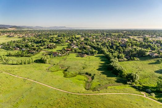 aerial view of foothills prairie in Colorado with a bike trail and residential area
