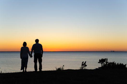 Watching sunset hand in hand