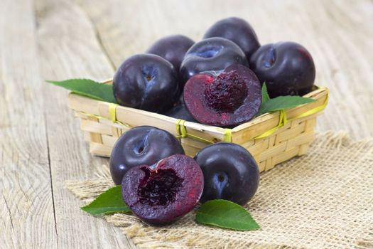 fresh fruits in a basket on wooden background