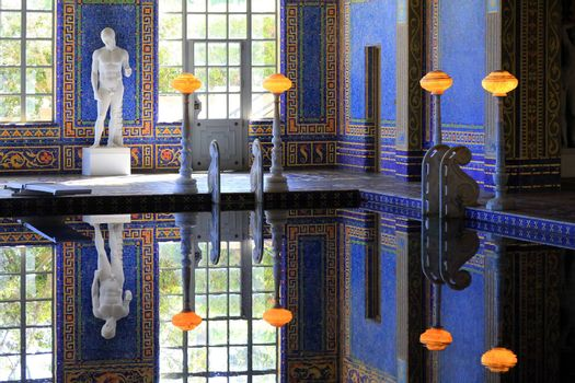 San Simeon, CA, USA - October 21.02012 : beautiful swimming pool with statues in Hearst Castle. National and California Historical Landmark mansion located on the Central Coast of California, United States. It was designed by architect Julia Morgan for newspaper magnate William Randolph Hearst, who died in 1951.
