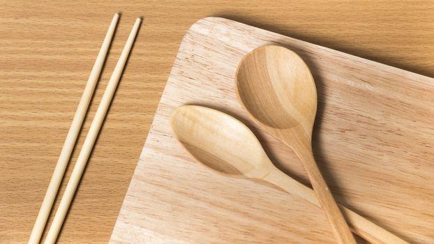 wood spoon with cutting board