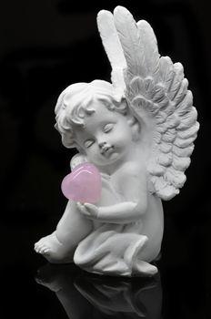 Beautiful White Angel isolated on black background